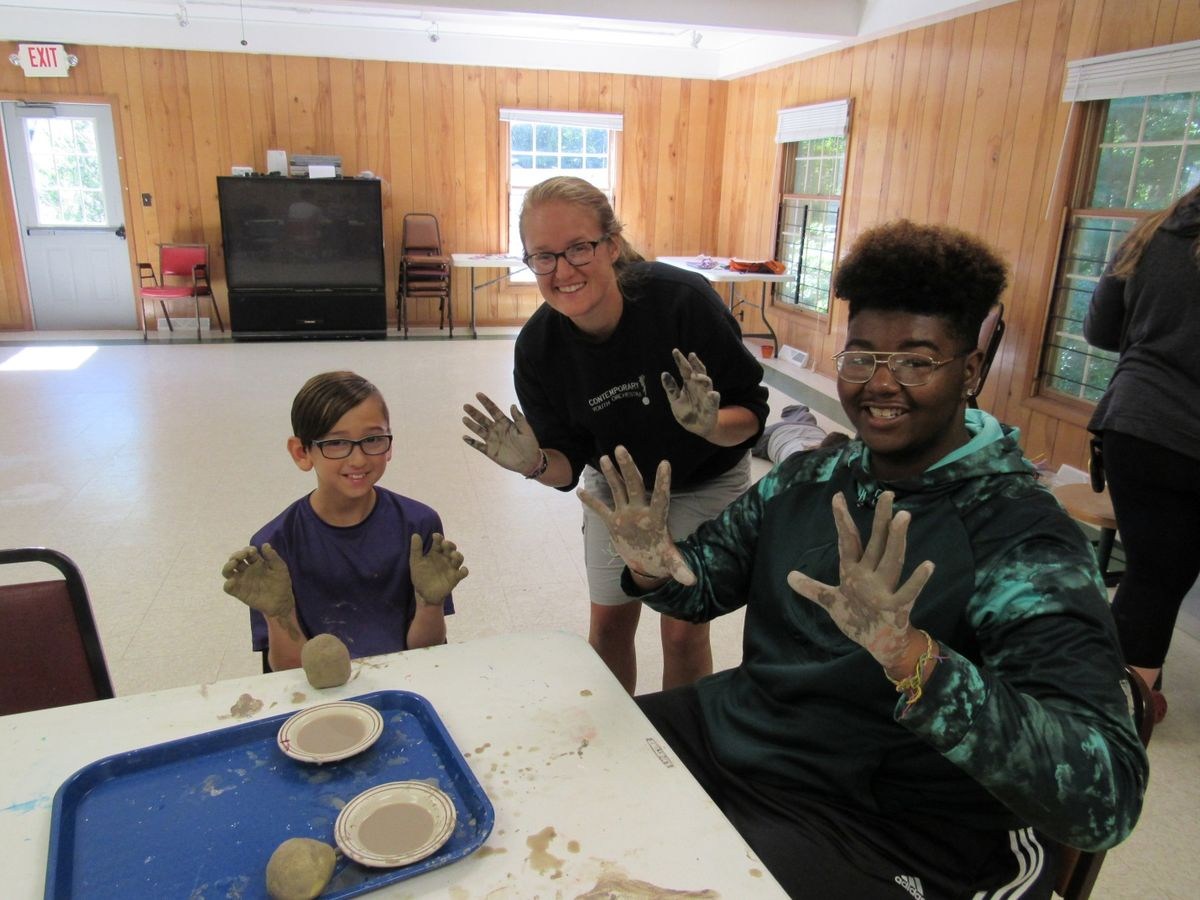 Campers doing a clay project.