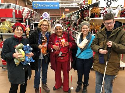 Volunteers and clients holiday shopping.