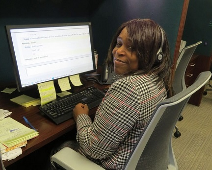 Rhonda Hills at her desk in the call center.