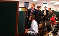 Secretary of State John Husted listening in to a call at CSC's call center.